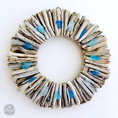 artist: Cherie Herne - driftwood wreath with beach glass