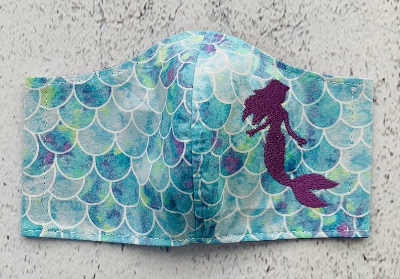Purple Mermaid Against Scales Backdrop Face Mask